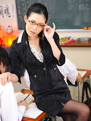 Teacher Yui Komine uses her whip in classroom