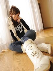 Brunette Emiri Seo poses in a room on floor