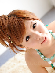 Arousing hot Japanese babe poses in a bikini