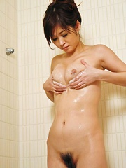 Moe Yoshikawa Asian with hot behind fondles her cans at shower