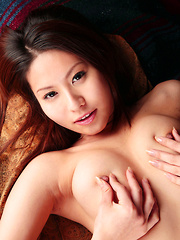 Sana Asian nymphet in blue sweater shows nude and naughty boobs